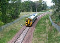 A mid morning train on the Borders Railway runs south through woodland near Arniston on 25 September 2015 heading for its next stop at Gorebridge.<br><br>[John Furnevel&nbsp;25/09/2015]