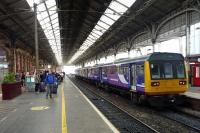 Northern Rail service to Colne awaits its departure, while passengers who had to leave an earlier service to Glasgow, await another train so they continue their journey.<br><br>[John Steven&nbsp;29/09/2015]