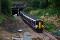 Just before passing through the tunnel under the Forth and Clyde Canal, 156449 on an Anniesland - Queen Street service passes the location of the junction for the new connection to the main line at Anniesland.<br><br>[Colin McDonald&nbsp;23/09/2015]