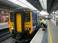Loading a bicycle onto a service to Manchester Airport at Preston.<br><br>[Veronica Clibbery&nbsp;17/09/2015]