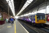 A Northern Rail service to Colne awaits its departure time at Preston station on 20 September, while passengers who had to leave an earlier service to Glasgow, await another train before they can continue their journey.<br><br>[John Steven&nbsp;20/09/2015]