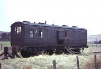 A modified ex-GSWR 6-wheel luggage brake van standing on the stub of the Wanlockhead branch at Elvanfoot in January 1967, some 28 years after closure of the branch. [Ref query 4644] <br><br>[John Robin&nbsp;02/01/1967]