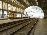 Looking north through the overall barrel roofed trainshed at Portbou in August 2015, with a Renfe Rodalies de Catalunya EMU seen stabled at platform 4.<br><br>[David Pesterfield&nbsp;07/08/2015]