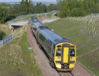 158739 and 158720 head north over the Gore Glen bridge with the 09.45 from Tweedbank to Edinburgh.<br><br>[Bill Roberton&nbsp;27/09/2015]