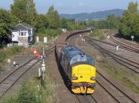 37259 brings up the rear of a steel sleeper train hauled by 66106 fro Mossend to Forsinard, and passes Stirling North 'box.<br><br>[Bill Roberton&nbsp;29/09/2015]