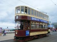 Bolton No.66, a regular on Heritage services in Blackpool, is seen with Blackpool North Pier in the background. The trolley pole isn't normally reversed here – heritage services usually continue to Bispham.<br><br>[Veronica Clibbery&nbsp;17/09/2015]