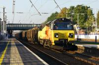 Leyland - Colas Railfreight have again started using Class 70 locos for the Carlisle to Chirk log trains. On 02 October 2015, the third day of running, 70805 heads south at Leyland in the afternoon sunshine.<br><br>[John McIntyre&nbsp;02/10/2015]