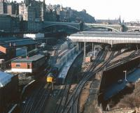 A 1977 view over the east end of Waverley from Regent Road, with a class 40 taking a train towards the Calton Tunnel. The train is passing the old East signal box, with New Street bus depot standing on the opposite side of the road bridge. Over on the left Waverley goods is still active, while beyond is the newly commissioned Edinburgh Signalling Centre. <br><br>[John Furnevel&nbsp;11/10/1977]