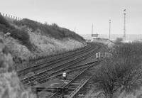Looking north over the connection to Seafield Colliery sidings in November 1988.  The pit had closed in March of that year.  In the background is Seafield Colliery Frame, relegated from a signalbox in 1979 as part of the Edinburgh Resignalling.<br><br>[Bill Roberton&nbsp;/11/1988]