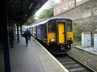 Northern Sprinter 150275 calls at Wigan Wallgate on a service heading for Manchester. There was originally an additional line through the cutting here but it was lifted a long time ago. <br><br>[Veronica Clibbery&nbsp;17/09/2015]