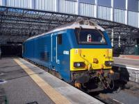 A very clean Caledonian Sleeper locomotive 67003 basks in the September sunshine at the east end of Waverley.<br><br>[Andrew Wilson&nbsp;24/09/2015]