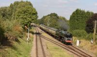 Green 9F 92214 approaching Quorn and Woodhouse station during the Great Central 2015 gala weekend on 2nd October. The 2-10-0 has been performing at various locations around the UK during 2015 [See image 50674]<br><br>[Peter Todd&nbsp;02/10/2015]
