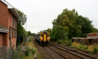 The 1037 Oban departure from Glasgow Queen Street passes Maryhill Park Junction on 23rd September 2015. On the left of the picture is the building which was intended to replace the original signalbox.<br><br>[Colin McDonald&nbsp;23/09/2015]