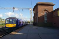 A Liverpool to Manchester Victoria service arrives at Edge Hill station on 09 October 2015. To the right of the station building is the eastbound line and a second island platform used by the services from the south.<br><br>[John McIntyre&nbsp;09/10/2015]