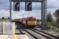Framed by  substantial signal gantry, DBS <I>Super 60</I> 60054 heads west through Didcot with the Murco tanks on 8th October 2015. This train runs from Theale in Berkshire to Robeston in South Wales.<br><br>[Peter Todd 08/10/2015]