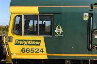 Close up of the cab of Freightliner 66524, including a Health and Safety reminder to staff alongside the driver's window. The loco was passing through Didcot on an infrastructure working to Southampton. <br><br>[Peter Todd 08/10/2015]