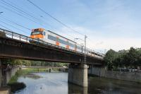 A RENFE Class 447 EMU heads south from Girona and crosses the River Onyar with a stopping train for Barcelona. This bridge is just by the Basilica church on the edge of the old town area of the city. <br><br>[Mark Bartlett&nbsp;17/09/2015]