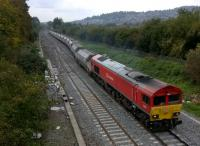 Having waited patiently for an up HST to pass, DBS liveried 59201 snakes out of the loop to turn right towards the coast. The load was ballast; I believe this was a 13.20 Westerleigh to Westbury working. The ramshackle hut see image [[42584]] has been flattened as part of the renewal of the junction.<br><br>[Ken Strachan 10/10/2015]