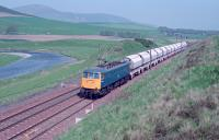 Limestone empties from Ravenscraig heading south to Hardendale Quarry passing Roberton, south of Lamington, in 1988<br><br>[Ewan Crawford&nbsp;//1988]