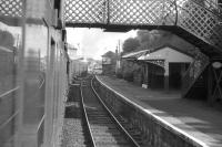 Photograph taken from a carriage window on a train leaving Clarkston station on 20 June 1964 behind BR standard tank 80120. The train is the 8.16am to Glasgow St Enoch, which will shortly pass a DMU, just visible in the background, approaching with a service for East Kilbride.    <br><br>[John Robin 20/06/1964]