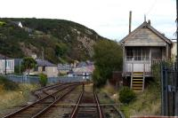 The disused Pwllheli West box still survives along with a short section of double track approaching the station, which formerly had an island platform with loco release roads.<br><br>[Colin McDonald&nbsp;14/10/2015]