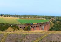 The return working of the empty ballast hoppers from Forsinard to Carlisle, pictured crossing Culloden Viaduct, double headed by 66106 and 37259.<br><br>[John Gray&nbsp;15/10/2015]