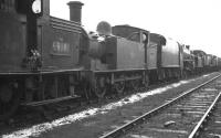 Locomotives awaiting disposal in the sidings at Bo'ness Harbour in February 1962. Nearest is NB N15 0-6-2T 69181, with sister locomotive 69131 standing beyond. Both had been withdrawn from Eastfield shed earlier that month. <br><br>[K A Gray&nbsp;26/02/1962]