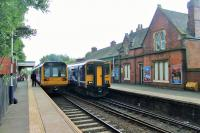 The fine looking station building at Romiley is still fully staffed and the station enjoys regular services to Manchester Piccadilly via both Hyde and Reddish. Here a Pacer heading for the Rose Hill branch meets a Sprinter going into the city on 1st September 2015.<br><br>[Mark Bartlett&nbsp;01/09/2015]
