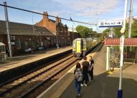 The 1655 train to Ayr coasts into Johnstone station on 14th July 2015. I wonder if the collective noun for three teenagers is an 'app?'<br><br>[Ken Strachan&nbsp;14/07/2015]