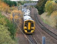 The 1016 service to Waverley (0928 ex-Tweedbank) pulls away from a leafy Brunstane station on 21 October 2015.<br><br>[John Furnevel&nbsp;21/10/2015]