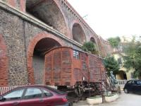 This Spanish fruit wagon is displayed on a car park in Cerbere, dwarfed by the arches that carry the main line railway and SNCF station above. Its an Iberian (broad) gauge wagon and the short length of track it stands on is mixed gauge. <br><br>[John Yellowlees&nbsp;16/10/2015]