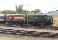 A little bit of <I>Before and After</I> on display at the Great Central Railway. Nicely restored to BR Green livery, Class 08 D3690 stands next to classmate 08694, which is in a more <I>as received</I> condition of faded EWS maroon and gold. Seen from a train departing from Loughborough Central for Leicester North. <br><br>[Mark Bartlett&nbsp;29/08/2015]