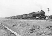 An interesting looking freight heading towards Glagow past Clydebank East Junction on 12 April 1958. Locomotive is Gresley K4 2-6-0 no 61996 <I>Lord of the Isles</I>. [See image 50724]<br><br>[G H Robin collection by courtesy of the Mitchell Library, Glasgow&nbsp;12/04/1958]