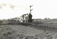 Ex-LMS 4F 0-6-0 44331 approaching the site of Monkton Junction with a northbound freight on 28 March 1959. The town of Prestwick stands in the background. [Ref query 3418]<br><br>[G H Robin collection by courtesy of the Mitchell Library, Glasgow&nbsp;28/03/1959]