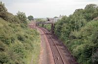 The bridge, seen here, which formerly carried the Solway Junction Railway over the G&SWR later bore the effluent pipeline from Chapelcross. Shawhill station was not far to the north (left) and a west to south curve connected the G&SWR with the SJR. The G&SWR line has since been re-doubled. View looks east.<br><br>[Ewan Crawford&nbsp;//1998]
