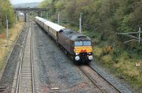 The <I>Entente Cordiale</I>, a private charter from Carnforth to Spean Bridge, runs through Clifton and Lowther on 23rd October 2015. The train comprised West Coast 57601, complete with headboard and Anglo-French bunting, and six gleaming Pullman coaches. Photographed from the bridge at Grid Reference NY541257. The old station, closed in 1938, lay just beyond the three arch bridge.<br><br>[Mark Bartlett&nbsp;23/10/2015]
