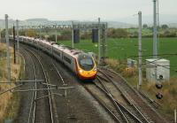 Euston bound 390121 speeds past the Eden Goods Loop at Clifton and Lowther on 23rd October 2015. The tracks are widening at this point because they pass under a twin arch bridge. (Grid Reference NY541257)<br><br>[Mark Bartlett&nbsp;23/10/2015]