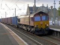 DBS 66176 coasts through Kirknewton with a well-loaded intermodal service from Mossend to Tees Dock, a fairly new introduction.<br><br>[Bill Roberton&nbsp;23/10/2015]