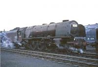 Night shift. Scene in the yard at Polmadie on a summer evening in 1964, as Stanier Pacific 46244 <I>King George VI</I> prepares to go off shed and make the short journey to Glasgow Central. The locomotive will  later take out the London sleeper. <br><br>[John Robin&nbsp;17/07/1964]