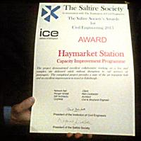 [See news item!] Work to improve Haymarket station has received an award. The citation reads:<br><br> <br><br> The Saltire Society in association with The Institution of Civil Engineers<br><br> The Saltire Society's Awards for Civil Engineering 2015<br><br> <br><br> Award - Haymarket Station - Capacity Improvement Programme<br><br> <br><br> The project demonstrated excellent collaborative working on a live and complex site delivered safely without disruption to rail services or passengers. The completed project provides a state of the art transport hub and an excellent improvement to travel in Edinburgh.<br><br> <br><br> Network Rail : Client<br><br> Morgan Sindall : Main Contractor<br><br> IDP Architects : Architect<br><br> CH2MHill : Civil & Structural Engineer<br><br> <br><br> (Signed by the presidents of the two societies.)<br><br>[John Yellowlees&nbsp;//]