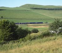 The first service train on the Borders Railway accelerates away from the stop at Stow towards Galabank Junction. This was the 0845 from Tweedbank, formed by 3x2 car 158 units, on 6th September 2015. Cribbilaw Hill (350m) dominates the background scenery. <br><br>[Bill Jamieson&nbsp;06/09/2015]
