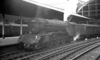 Gresley V2 2-6-2 60963, one of the few examples of the class to be fitted with a double chimney, stands with a train at Newcastle Central in the early 1960s. The locomotive was withdrawn from York in June 1965.<br><br>[K A Gray&nbsp;//]