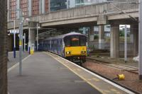 318258 arrives at Exhibition Centre with a westbound service on 02 August 2015.<br><br>[John McIntyre&nbsp;02/08/2015]