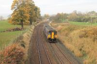 Autumn colours in Ribblesdale as Northern Sprinter 150270, on a Morecambe to Leeds service, pulls away from Long Preston station on 31st October 2015. The next stop at Hellifield is only a very short distance away.<br><br>[Mark Bartlett&nbsp;31/10/2015]