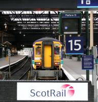 ScotRail 156450 stands at the buffer stops at Waverley platform 15, adjacent to a neat and tidy west end concourse, during a quiet period on 29 October 2006 [see image 8251].<br><br>[John Furnevel&nbsp;29/10/2006]