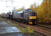 The empty coaching stock movement from Fort William to Carnforth on the Saturday the 24th of October passing through Coatbridge Central some two hours late.<br><br>[Alastair McLellan&nbsp;24/10/2015]
