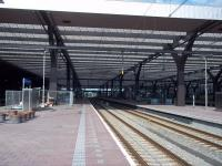 Rotterdam Centraal: The trainshed from the east end, 250 metres from end to end. Prior to redevelopment and eventual reopening in 2014, the platforms had individual canopies, although still entered from lower ground level. Now the overall roof extends across all platforms. <br><br>[Andrew Wilson&nbsp;18/07/2015]