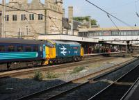 With their enthusiastic following, all the Class 37s used on Cumbrian Coast passenger services could be classed as <I>celebrities</I>. However, 37401 <I>Mary Queen of Scots</I>, in its West Highland livery, is a bit special and made a fine sight in Lancaster on 11th September 2015 with the weekday 1004 Preston to Barrow-in-Furness service.<br><br>[Mark Bartlett&nbsp;11/09/2015]