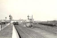 Workers platforms at Singer, looking west in April 1958. At its peak the huge factory employed over 16,000 workers. Final closure came in June 1980 and the last of the building complex was demolished in 1998. Much of the site is now occupied by the Clydebank Shopping Centre [see image 7266]. <br><br>[G H Robin collection by courtesy of the Mitchell Library, Glasgow&nbsp;12/04/1958]