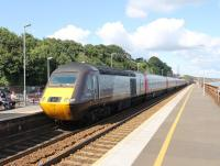 A Cross Country HST hurries through Dawlish with a Plymouth to Edinburgh service on 29th July 2015. Power car 43321 brings up the rear as the train passes the platforms where there is much evidence of refurbishment work after the winter storm damage.<br><br>[Mark Bartlett&nbsp;29/07/2015]